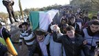 Anti-government protesters carry coffin of man killed during recent clashes in Idlib, northern Syria