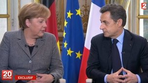 Angela Merkel and Nicolas Sarkozy during TV interview - 6 February