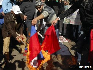Lebanese and Syrian protesters burn a Chinese and Russian flag in front of the Russian embassy in Beirut, 5 February 2012