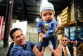 Republican presidential candidate Mitt Romney hands six-month-old Dexter Hall of Plymouth, Minnesota. back to his mother