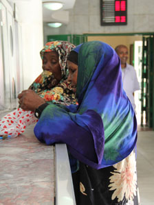 Women collect money at Dahabshiil money transfer centre in Hargeisa. Photo by Jacques Sweeney