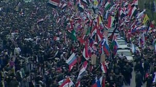 Crowds waving flags in Damascas