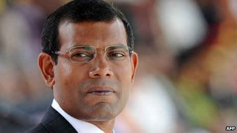 In this photograph taken on December 27, 2011, Maldivian President Mohamed Nasheed looks on while attending a military parade in the central Sri Lankan town of Diyatalawa
