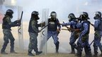 Maldives soldiers, left, are involved in a clash with police officers, right, in Male, Maldives, Tuesday, Feb. 7, 2012.
