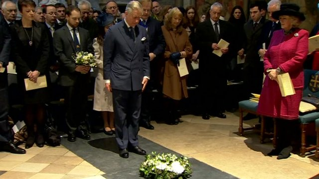 Prince Charles laying wreath