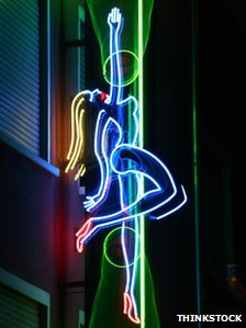 Neon sign advertising a pole dancing club