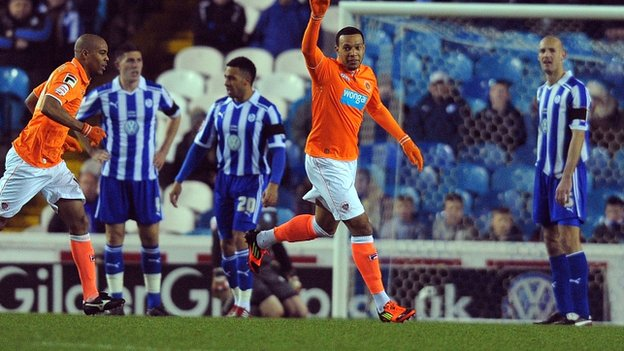 Matt Phillips celebrates Blackpool's opener