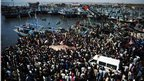 Crowds gather to see a dead whale shark in Karachi, Pakistan on 7 February 2012