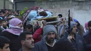 Dead man carried in a funeral procession in Homs, Syria (image made available 7 Feb 2012)