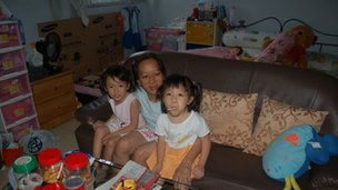 Ng Siew Teen and her daughters at home in Singapore on 2 February, 2012