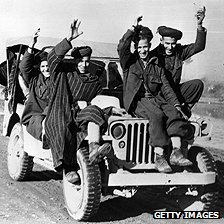 French fighters hitch a ride on a jeep in 1944