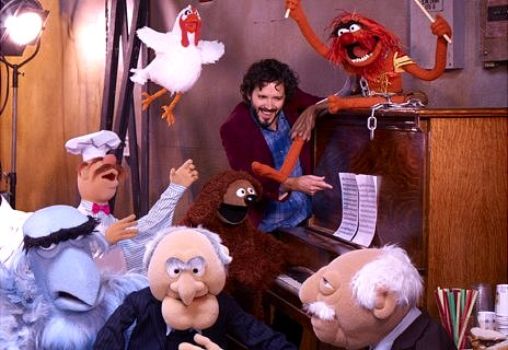 Bret McKenzie (centre) amidst the mayhem of the Muppets