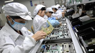 Workers at a plant of the Taiwanese manufacturing giant Foxconn in the southern Chinese city of Shenzhen