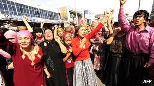 Muslim ethnic Uighurs protest in Urumqi, Xinjiang province, following clashes between ethnic Uighurs and Han in July 2009