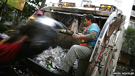 Loading up rubbish in Mexico City