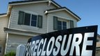 US home with Foreclosure sign