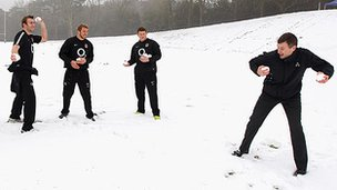 England players Ben Foden, Tom Croft, Chris Robshaw and Dylan Hartley pelt Ronan Dunne of O2