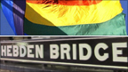 Gay Pride flag and Hebden Bridge sign