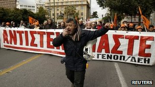 Members of Greece&#039;s public power corporation workers union (GENOP) march during a protest in Athens February 9