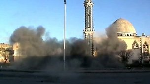 Video image of a blast in front of a mosque in the Baba Amr district of Homs, 8 February