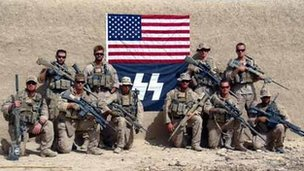 US Marines posing in front of flag bearing SS logo (Photo provided by Military Religious Freedom Organisation)