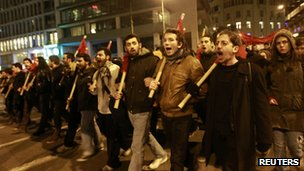 Protesters march during a rally against austerity measures in Athens on 9 February 