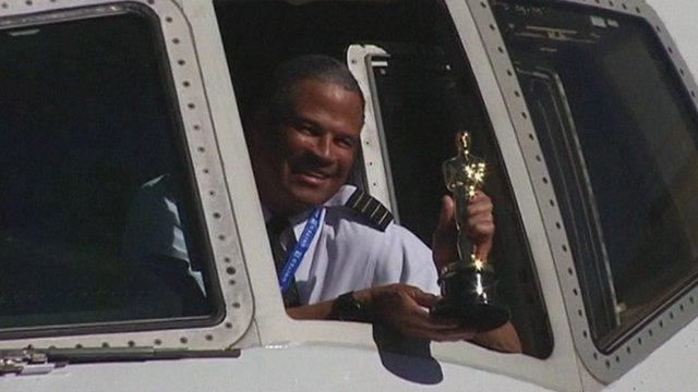 A pilot with an Oscar statuette
