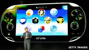 Kazuo Hirai with the PlayStation Vita