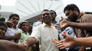 Former Maldives President Mohamed Nasheed greets people after prayers in Male. Photo: 10 February 2012