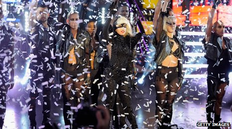 Lady Gaga on stage surrounded by fake snow