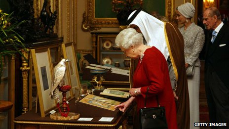 Queen Elizabeth II shows the Emir of Qatar, Sheikh Hamad bin Khalifa al-Thani, around exhibits from the Royal Collection