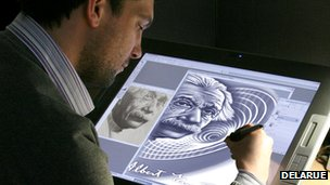 Currency designer working on banknote design