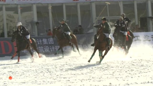 Players playing snow polo