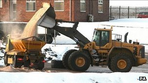A digger fills a truck with rock salt - generic image