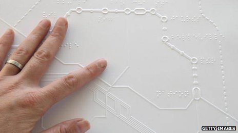 Reading a Braille map of the Paris Metro