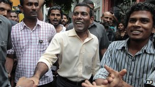 Former Maldivian president Mohamed Nasheed. centre, greets supporters outside his residence in Male, Maldives, Thursday, Feb. 9, 2012