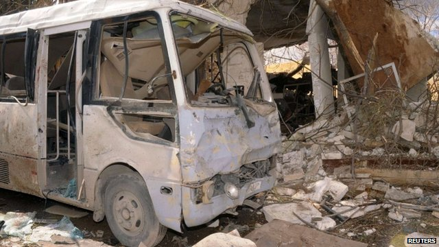 Bomb-hit bus in Aleppo