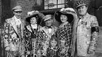 London's Pearly Kings and Queens wear traditional suits covered with pearl buttons.