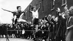 East London Schools Hurdles champion Grace Adams racing on the Poplar street track in preparation for the annual contest, in 1936
