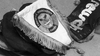 The emblem of the national Zambian football team and some belongings of players found by Gabonese divers at sea