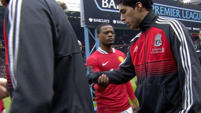 Suarez refuses Evra handshake