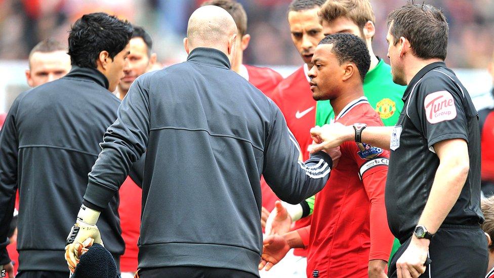 Luis Suarez fails to shake Patrice Evra's hand
