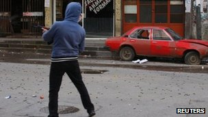 A gunman fires in Tripoli, Lebanon. Photo: 11 February 2012