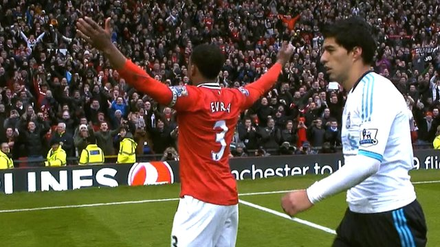 Patrice Evra celebrates in front of the Stretford End