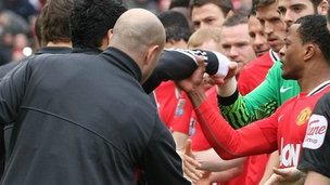 Manchester United's Patrice Evra reacts angrily after being snubbed by Liverpool's Luis Suarez in the pre-match handshake