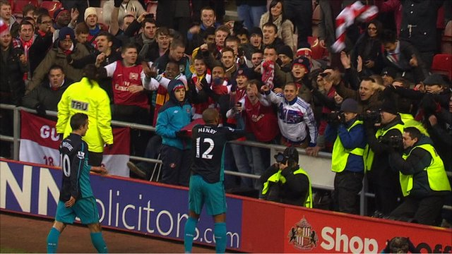 Thierry Henry celebrates with Arsenal's fans