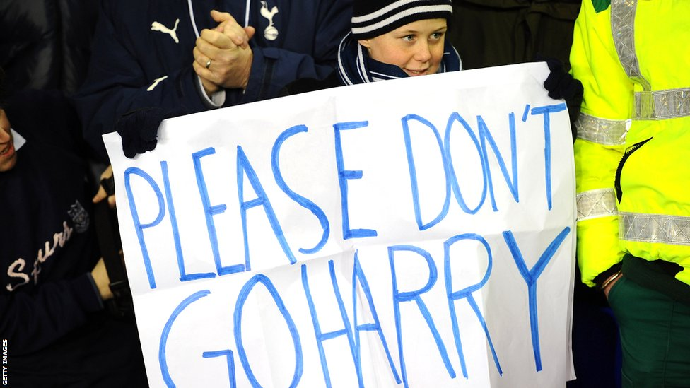 Child holding a sign: Please Don't Go Harry