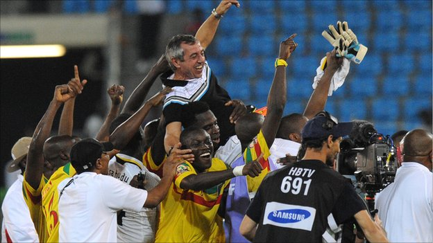 Mali coach Alain Giresse is given the bumps by his delighted squad