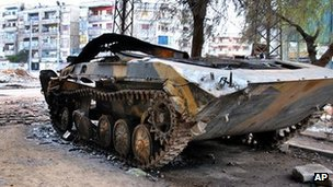 A burned government tank in Homs, Syria (8 Feb 2011)