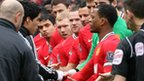Liverpool striker Luis Suarez refuses the hand of Manchester United defender Patrice Evra